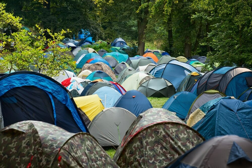 A picture showing Many tents at a festival campsite