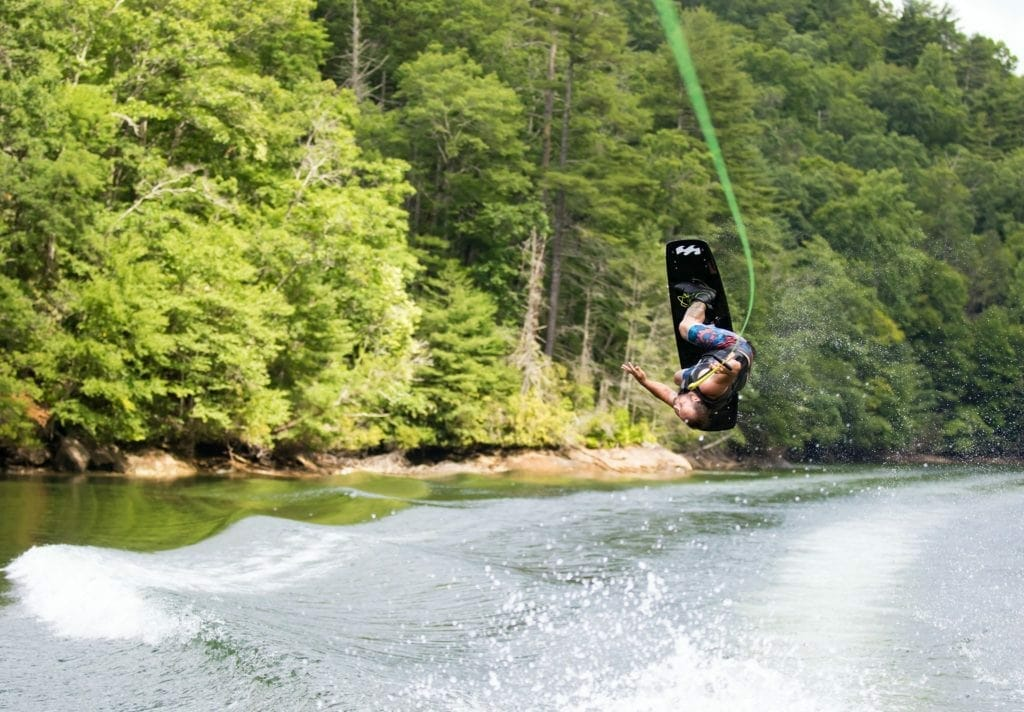 A picture showing a man wakeboarding in a lake